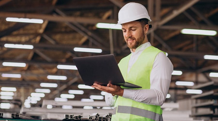 Young man engineer working on factory
